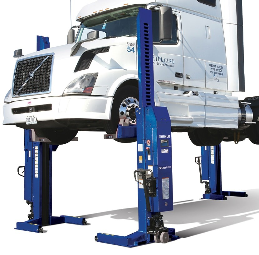 ShopPRO mobile column lifts lifting a heavy-duty truck